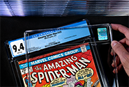 A CGC representative inserts a comic book and its label into CGC's archival holder during the CGC encapsulation process.