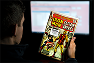 A CGC representative reviews a comic book submission to verify that its description matches information provided by the submitter.